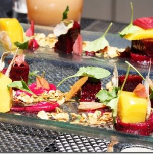 Mélange of Roast Beet with Arugula and Almond Granola