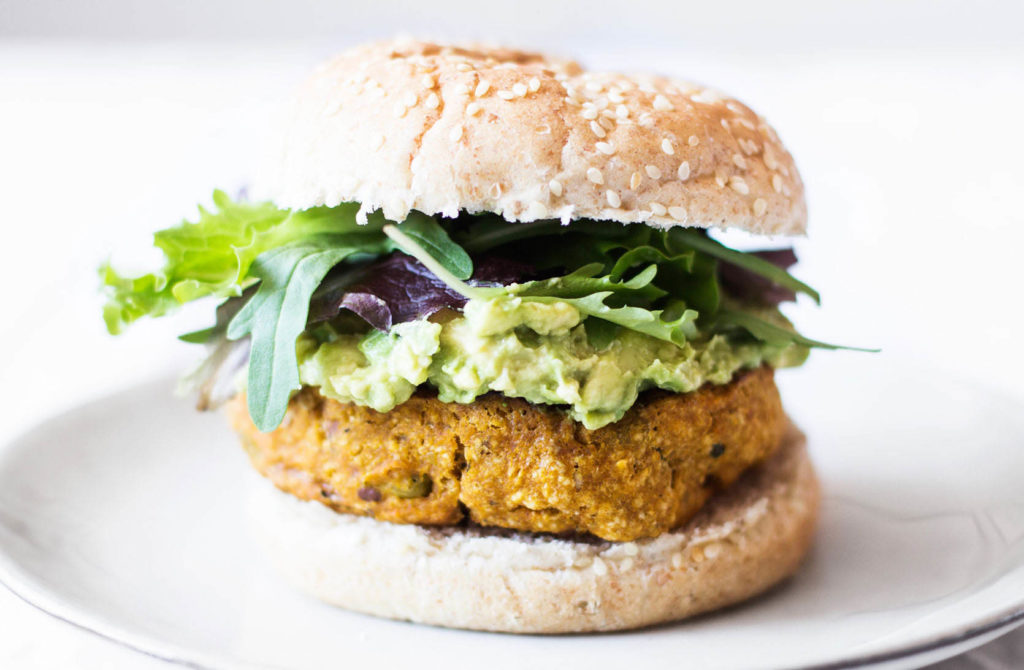 A plant based patty is served on a sesame bread roll.
