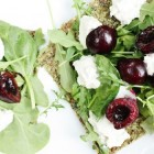 Raw Pizza with Rosemary Cashew Cheese, Arugula, and Balsamic Marinated Cherries