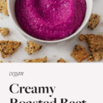 An image of bright pink, creamy roasted beet hummus.