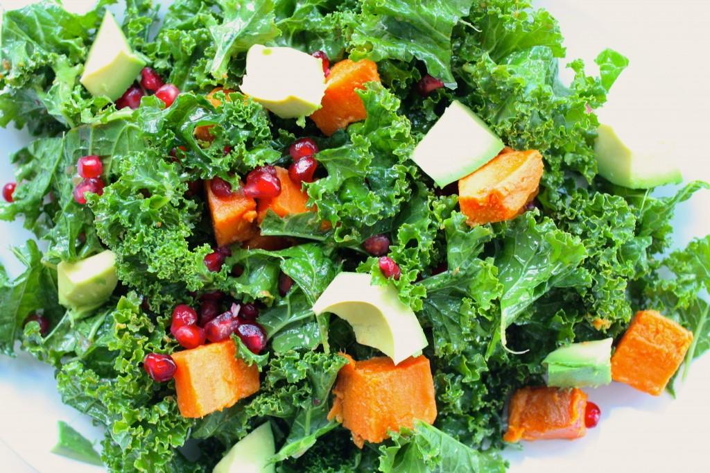 kale, sweet potato, pom salad closeup