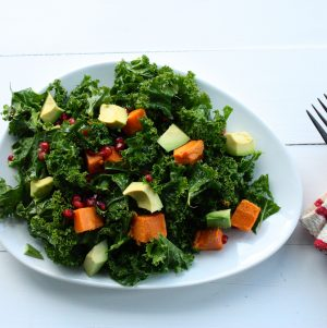 Kale Salad with Roasted Sweet Potato, Avocado, and Pomegranate Seeds