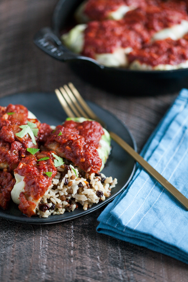 Comforting, hearty vegan stuffed cabbage rolls with rice, lentils, and currants | The Full Helping