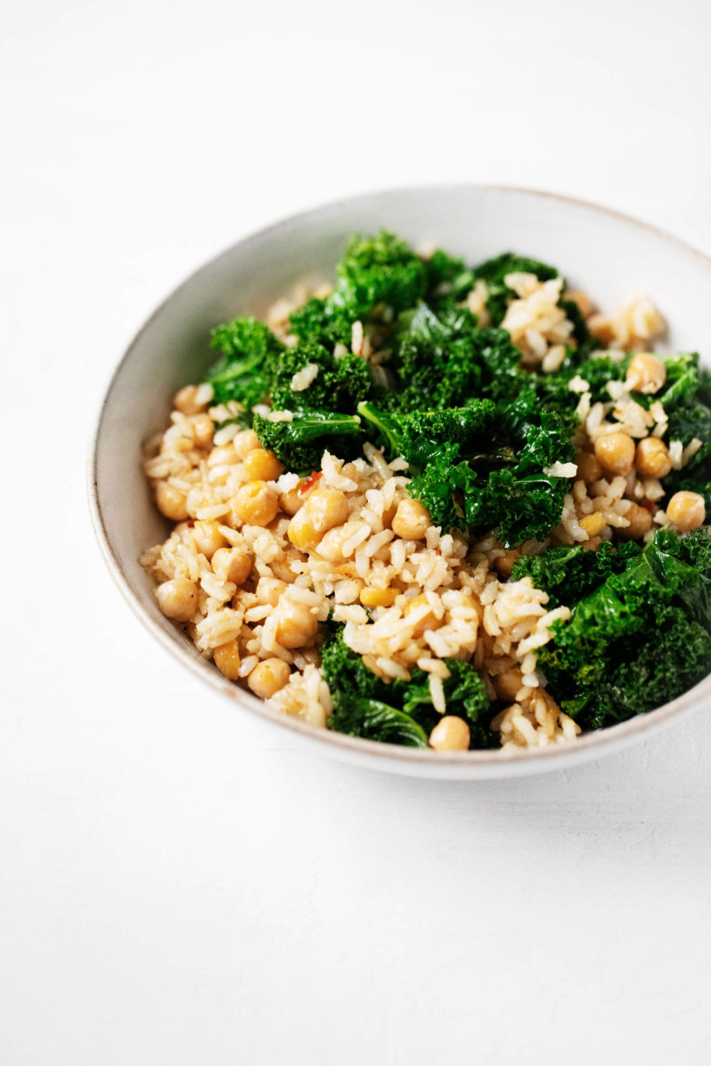 A grain, green and bean dish is nestled into a serving bowl.