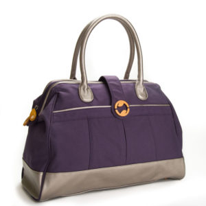 Cassia Weekender Vegan Leather + Organic Cotton Canvas Handbag in Indigo — Side Angle View