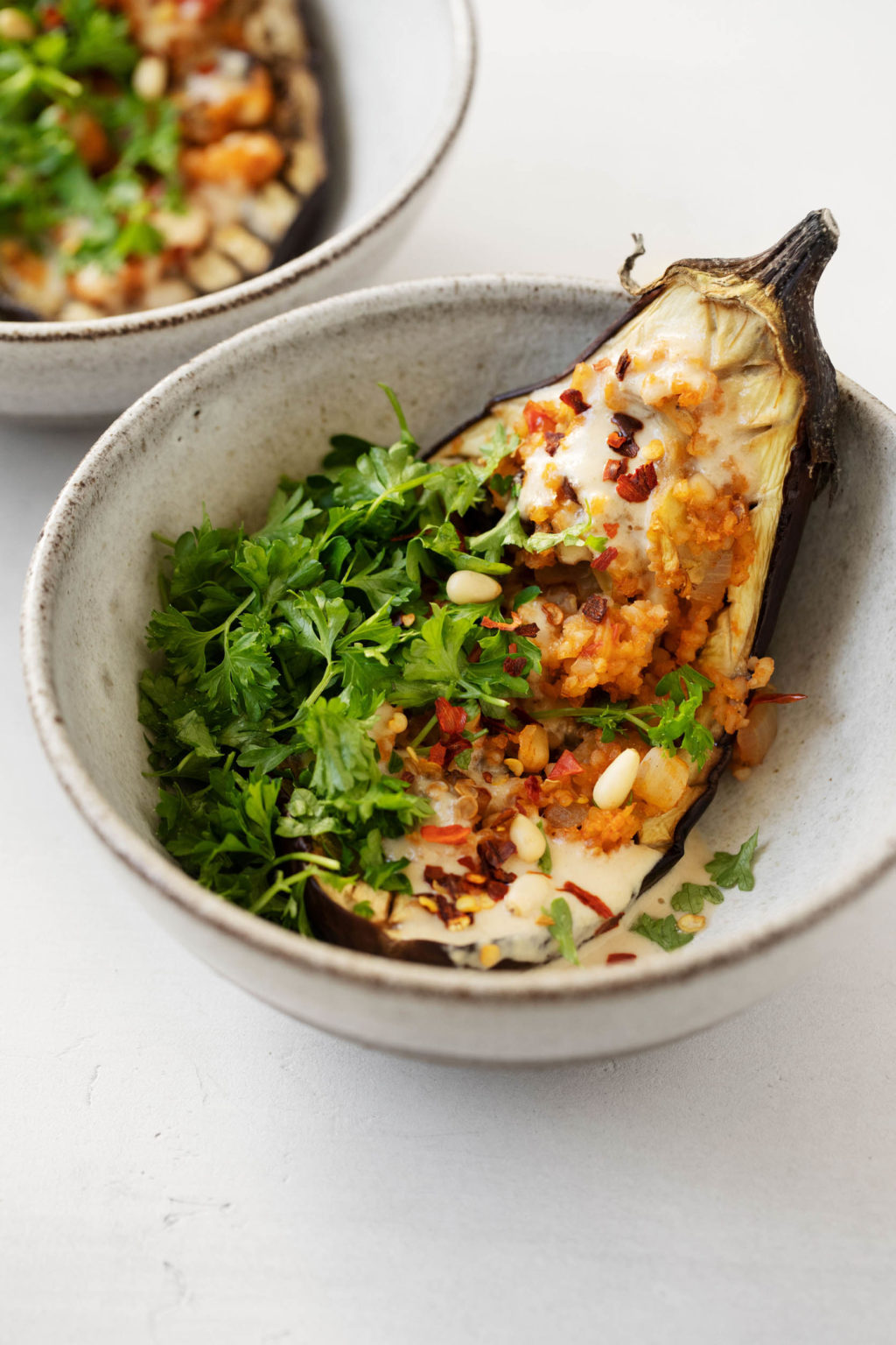 A sumptuous, plant-based stuffed eggplant with bulgur, currants, and pine nuts