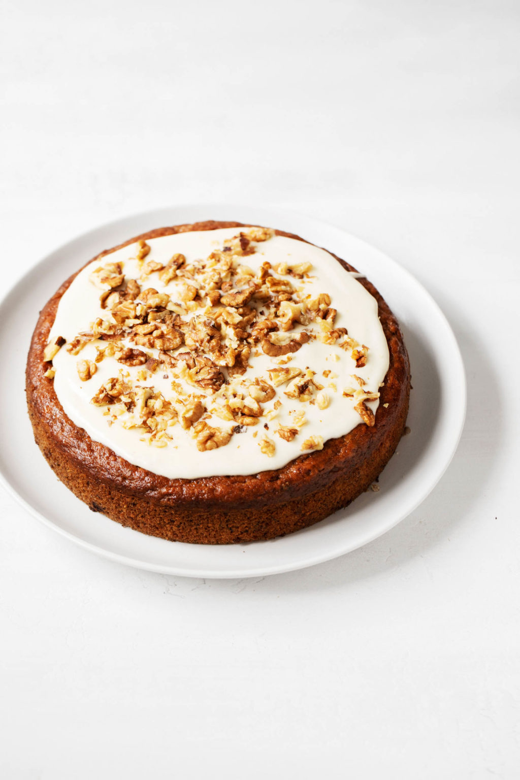 A round, simply decorated vegan banana cake.