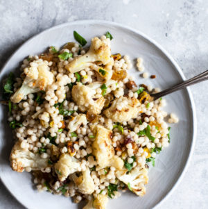 Israeli Couscous Salad with Roasted Cauliflower, Pistachios & Dates