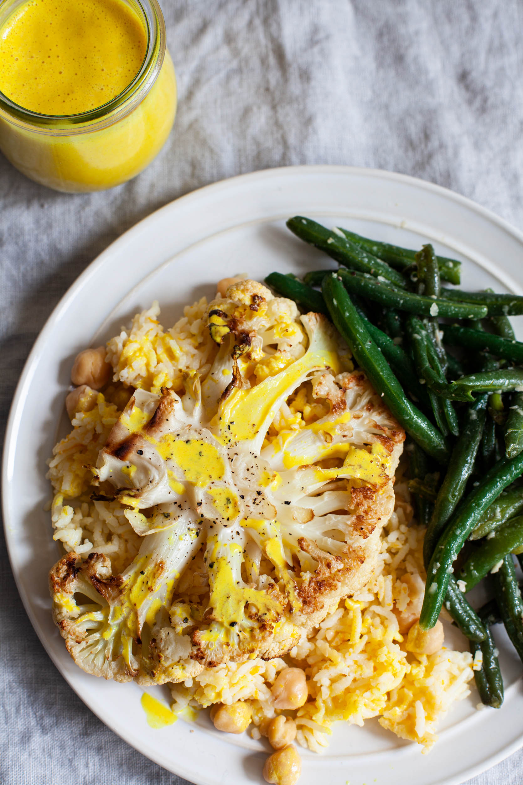 Cauliflower Steaks with Citrus Scented Rice and Creamy Orange Juice Turmeric Sauce