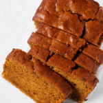 Newly baked pumpkin bread on a white kitchen countertop