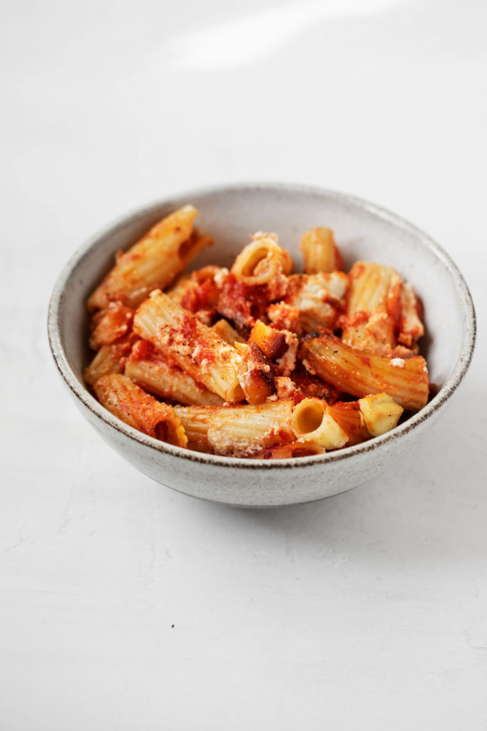 A small bowl of vegan eggplant baked rigatoni