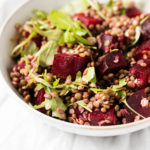 A vibrant, colorful bowl of a vegan lentil beet salad.