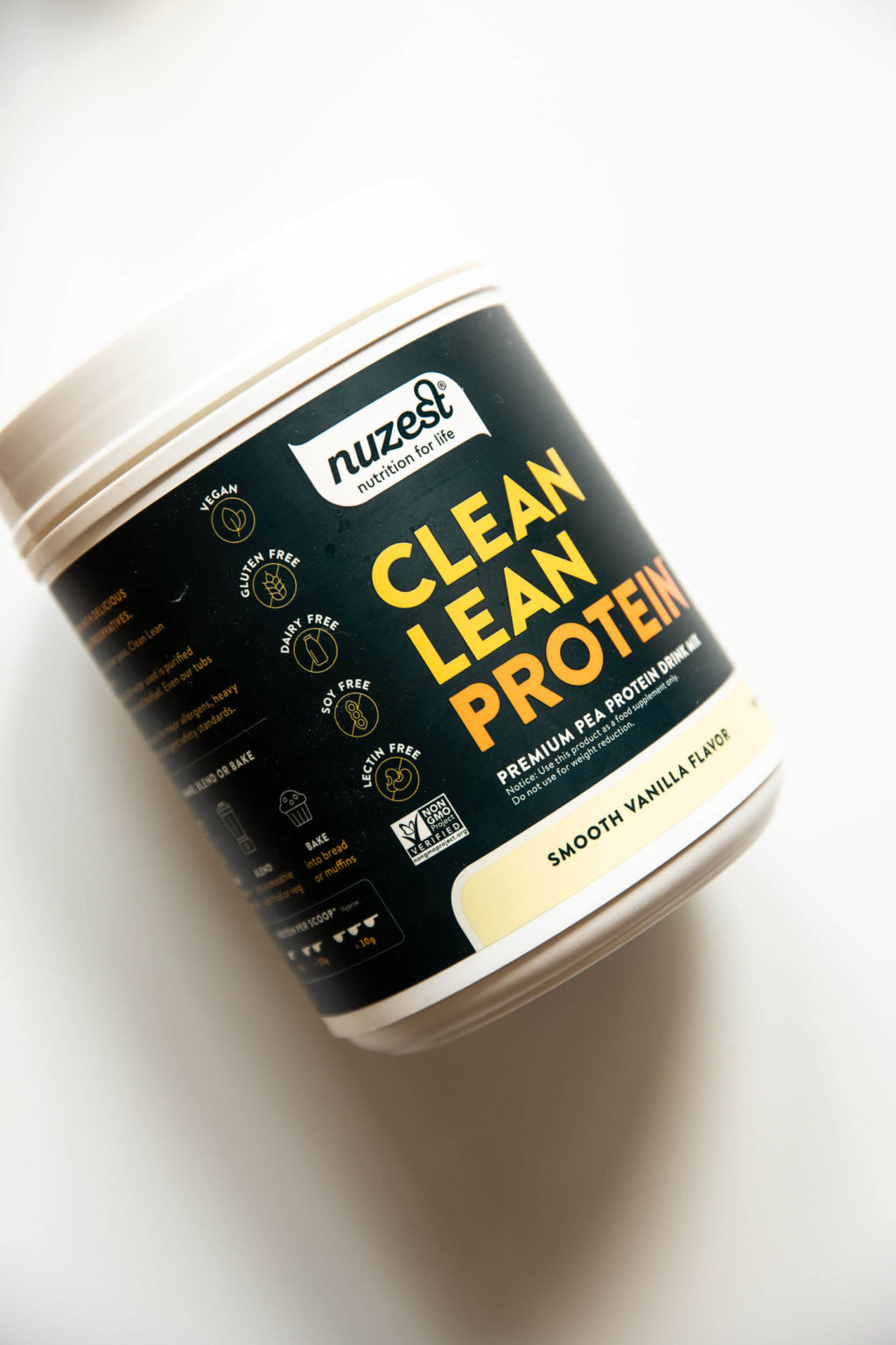 A container of plant based protein powder.